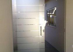 Jateamento de vidros laminados